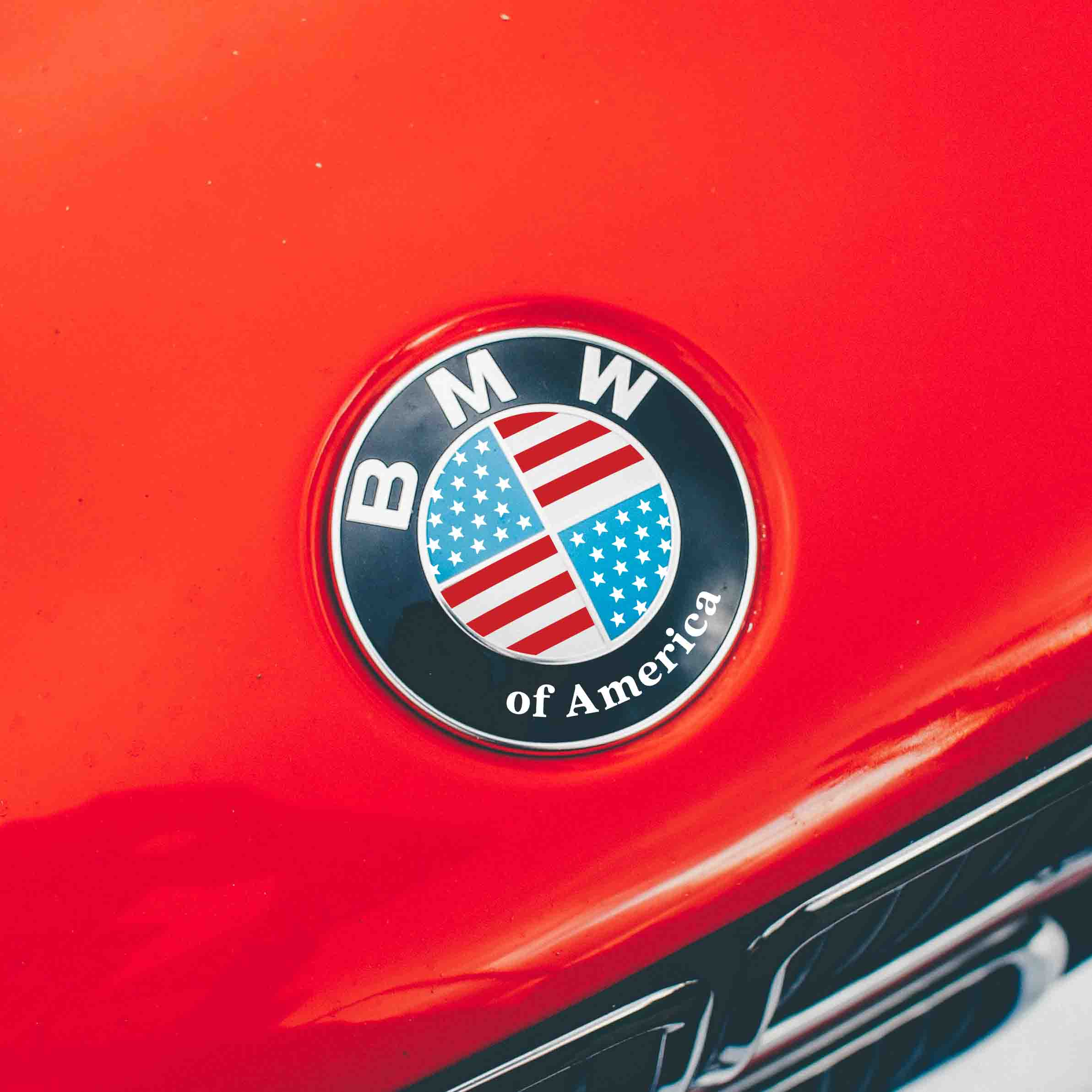 Overlay sticker that adds american flag over your BMW roundel emblem. Sticker features BMW of America lettering on the bottom.