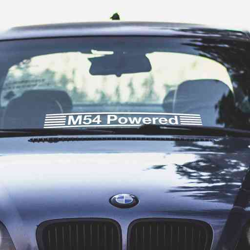 Custom BMW windshield sticker with wording 'Powered' and stripes. We make it for any engine model, you call it. Sticker is contour cut out of premium outdoor vinyls.