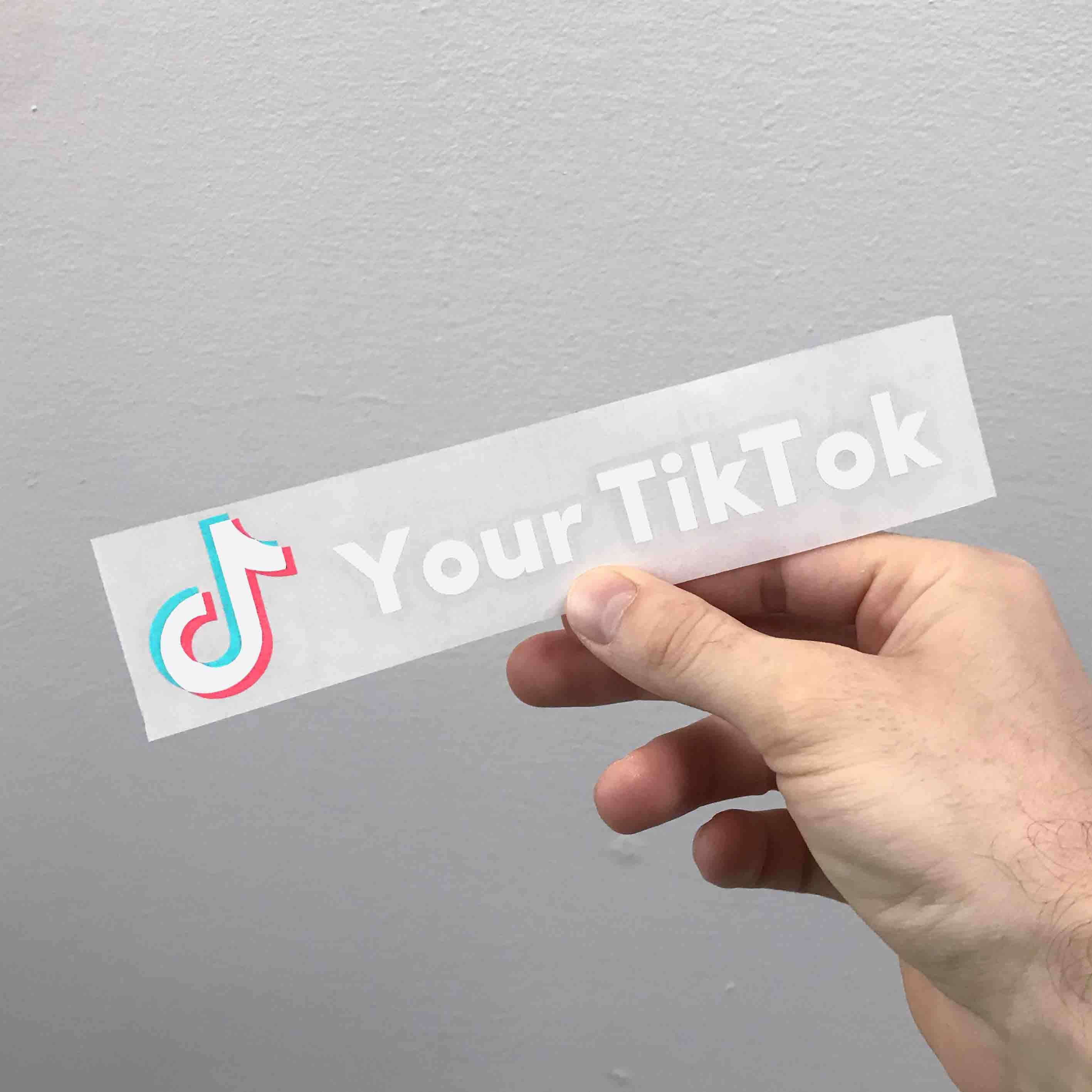 TikTok social network sticker with your account name on it. Available in light and dark color variations. Sticker is contour cut out of premium outdoor vinyls. Transparent background.