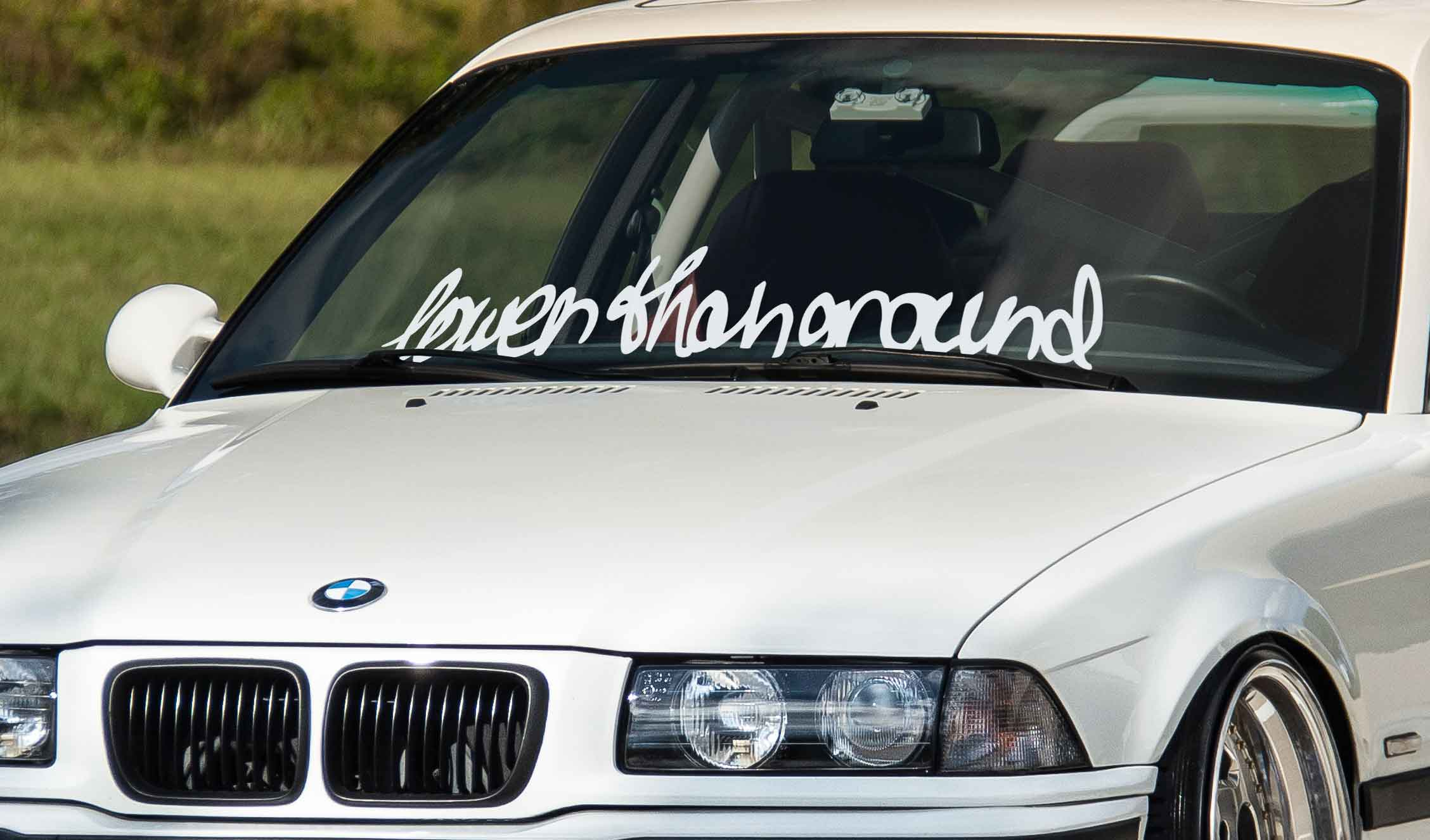 lLower than ground lowered car windshield banner